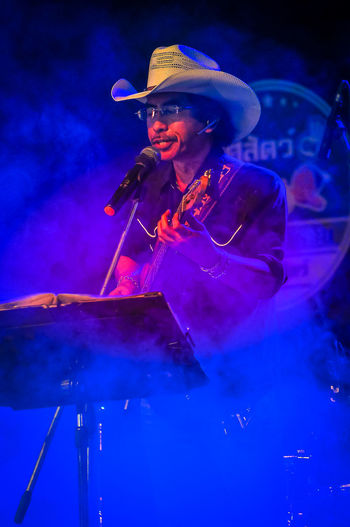 Cowboy Night Party at Nakhonsawan City, Thailand Cowboy Singer  Smoke Summer In The City The Maverick Adult Arts Culture And Entertainment Concert Country Music Hat Music Musician Night Nightlife One Person Showing Skill  คาวบอย นักร้อง เพลงคันทรี่ ギター奏者 主唱 吉他手 歌手 音樂會