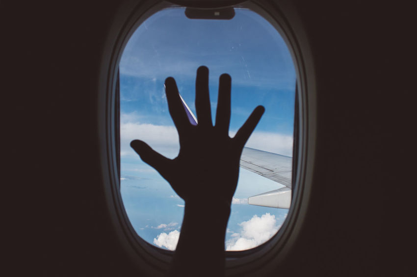 Travel vibe Adult Adults Only Airplane Day Gesturing Human Body Part Human Hand Minimal Minimalism One Person One Woman Only Only Women Outdoors People Sky Window Women
