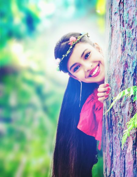 Young girl Beauty Red Tree Nature Outdoors Smiling Glamour Beauty In Nature peeping Peeking Through The Trees Long Hair