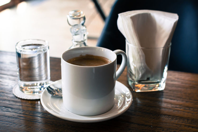 Beverage Cafe Close-up Coffee Coffee - Drink Coffee Cup Coffee Shop Cup Empty Focus On Foreground Freshness Frothy Drink No People Refreshment Saucer Selective Focus Serving Size Shop Still Life Table Tea Cup Wood - Material