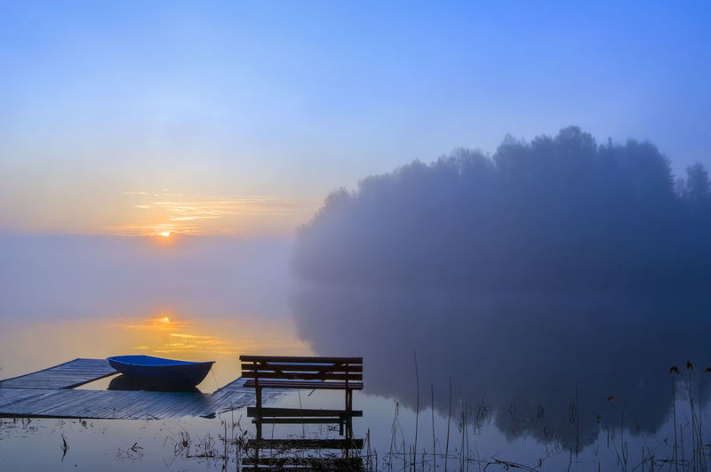 Sunrise on the lake Blue Non-urban Scene Boat Calm Coast Spring Lake Reflections Morning Outdoors Idyllic Orange Color Sun No People Nature Scenics - Nature Fog Sky Beauty Sunrise Bench