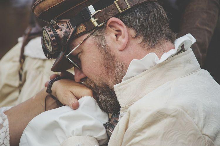 Close-up of man kissing hand