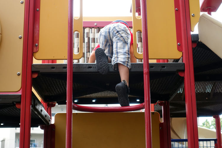 Rear view of man standing in playground