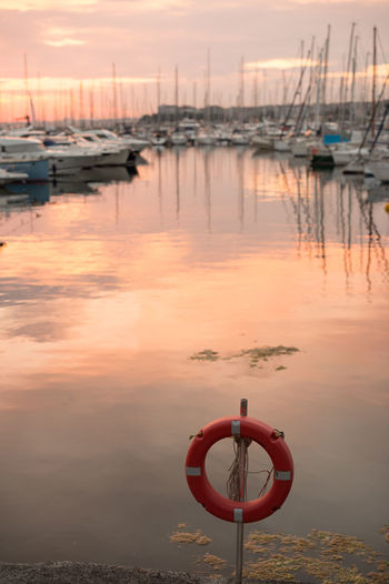 Lifesaver & Sunset Reflections by the Harbour Beauty In Nature Clouds And Sky Cloudscape Harbor Horizon Over Water Istanbul Lifesaver Marine Moored Nature Nature Photography Nature_collection Orange Orange Color Orange Sky Outdoors Red Reflection Scenics Sea Seascape Seaside Sunset Tranquility Water The Architect - 2017 EyeEm Awards Live For The Story