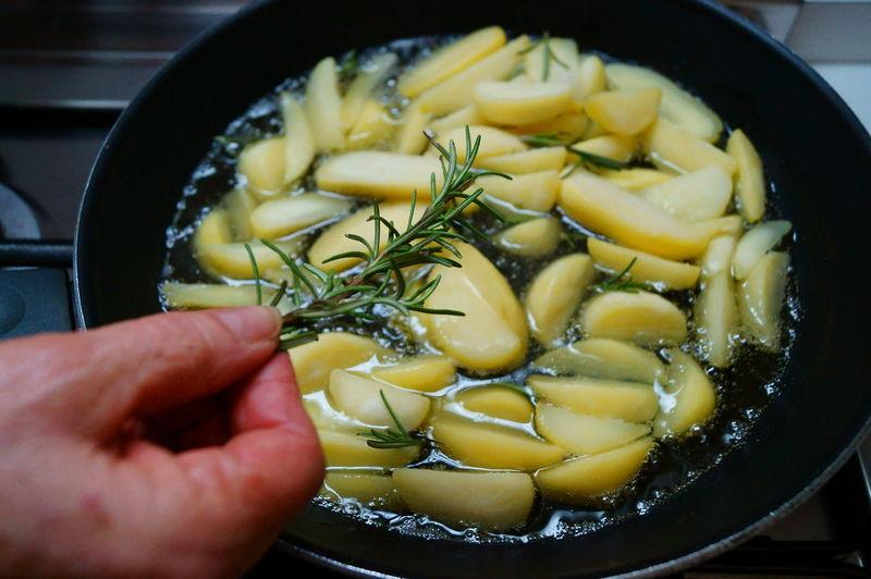 Close-up of hand preparing food