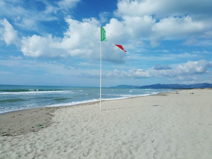 Beach Sea Land Sky Water Sand Nature Cloud - Sky Horizon Horizon Over Water Environment Beauty In Nature Tranquility Holiday Wind Flag Landscape Lanscape Photography EyeEmNewHere Tourism Travel Summer Exploratorium in Grosseto