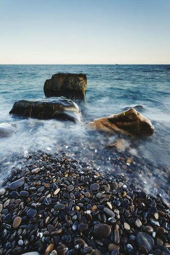 Sea Beach Horizon Over Water Rock - Object Clear Sky Sunset Pebble Breaking Water Beauty In Nature Sky Outdoors Blue Scenics Nature Wave No People Day Travel Destinations Italy🇮🇹 Italy❤️ Long Exposure Stones Rocks Beauty In Nature