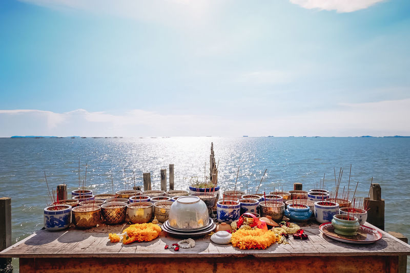 Cloud - Sky Incense Incense Sticks Nature No People Outdoors Religion Sea Sky Table Water