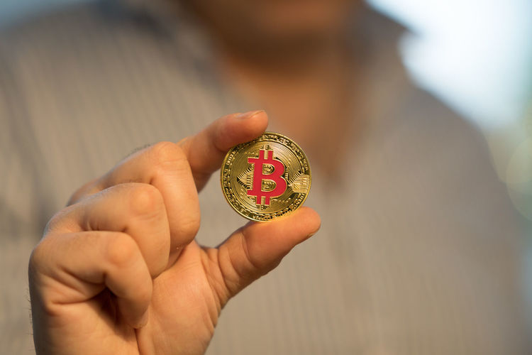 Close-Up Of Person Holding Bitcoin