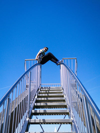 Railing One Person Clear Sky Full Length Low Angle View Mid-air Moving Down Outdoors Climbing One Man Only Motion