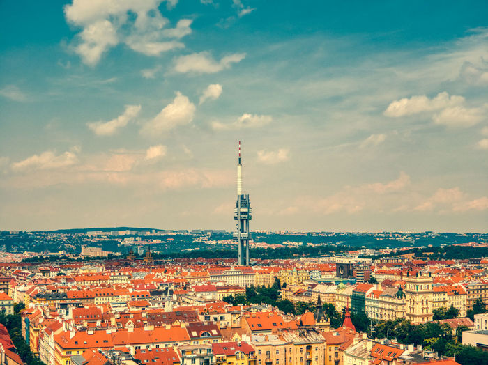 Aerial view of tv tower in prague zizkov under hot summer and clouds
