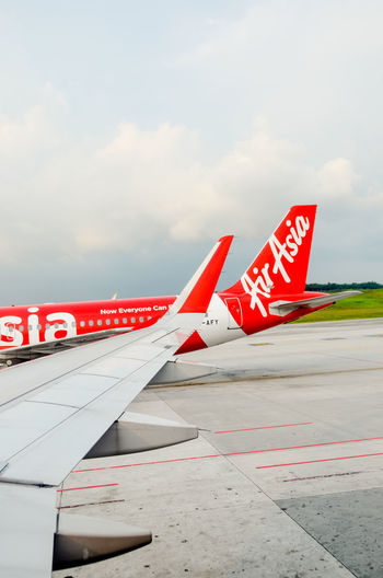 AirAsiaMalaysia AirAsiaThailand AirAsiaZest Airasiaindonesia Aerospace Industry Air Vehicle Airasia Airasia Malaysia Airasiax Airplane Airport Airport Runway Cloud - Sky Communication Day Mode Of Transportation Nature Nautical Vessel No People Outdoors Red Road Sign Sky Symbol Text Transportation Travel