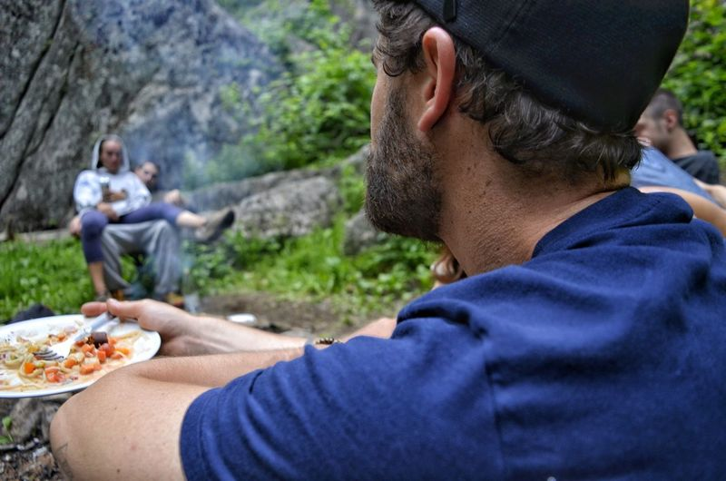Men Water Togetherness Eating Friendship Sitting Headshot Domestic Life Mid Adult Men Mid Adult Prepared Food