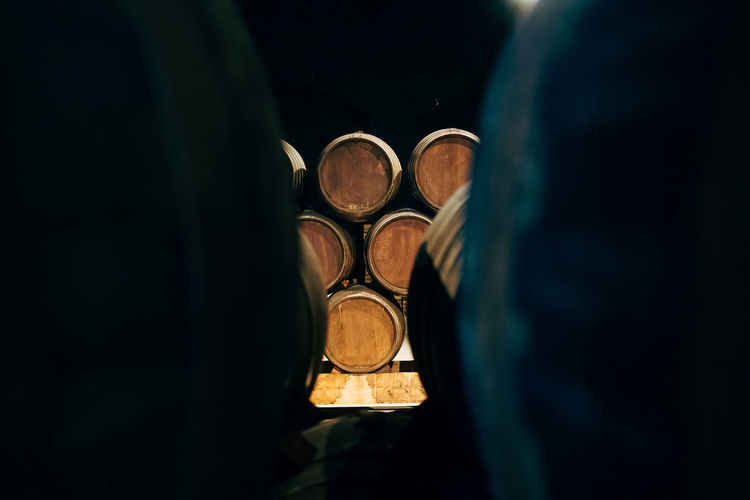 in the cellars of... Crafted Beauty Porto Tasting Dark Tasting Wine Barrels Wine Barrels Barrel Cellar Wineglass Darkness And Light Portwine Winebarrels Tasting Room Fivedaysporto