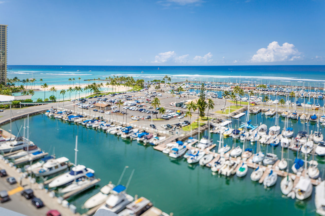 water, sea, sky, nature, high angle view, architecture, building exterior, horizon, city, built structure, horizon over water, blue, harbor, nautical vessel, no people, day, transportation, scenics - nature, outdoors, cityscape, yacht, turquoise colored, marina, sailboat, luxury, swimming pool