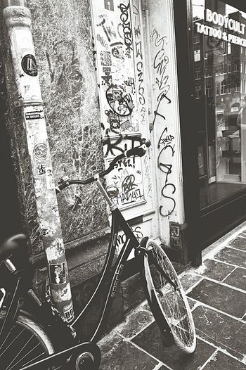 Graffiti in Amsterdam (unable to read so hope it doesn't cause offence ) Amsterdam Streets Amsterdam Life Bicycles Of Amsterdam Street Photography Bikes Tattoo Parlour Pavement Patterns Doorway Black & White Black And White Black & White Photography Black And White Photography Nikon D3200