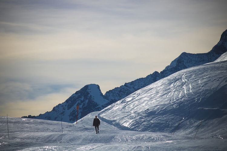 French Alps Alps Mountains Snow Winter Snowy Snowcapped Mountain Mountain Beauty In Nature Adventure Mountain Range Scenics - Nature Real People Sport Leisure Activity One Person Cold Temperature Non-urban Scene Sky Activity Tranquil Scene Cloud - Sky Unrecognizable Person Lifestyles Outdoors The Minimalist - 2019 EyeEm Awards