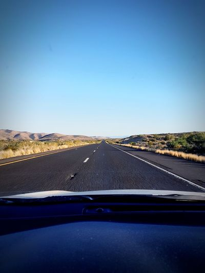 on the way back from Vegas Eyem Best Shots EyeEm Nature Lover PhonePhotography EyeEm Selects Desertroad Mountains Nature Photography Clear Sky Car Point Of View Road Road Trip Land Vehicle Car Interior Car Driving Blue Dashboard