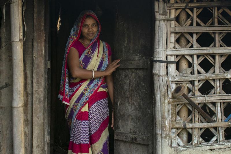Portrait of woman standing at door