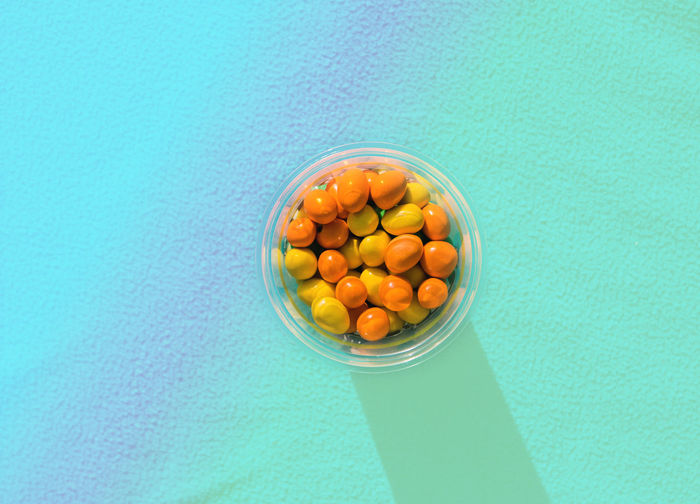 colorful chocolate balls candies in sugar glaze The Creative - 2018 EyeEm Awards Blue Blue Background Bowl Close-up Colored Background Container Directly Above Food Food And Drink Freshness Fruit Healthy Eating High Angle View Indoors  Large Group Of Objects No People Still Life Studio Shot Sweet Table Turquoise Colored Wellbeing