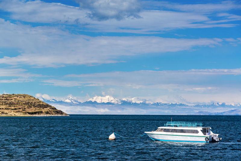 Andes Andes Mountains Blue Boat Bolivia Challapampa Cordillera Cordillera Real Isla Del Sol Lake Lake Titicaca Landscape Mountain Mountains Peru Ship South America Titicaca Travel Destinations