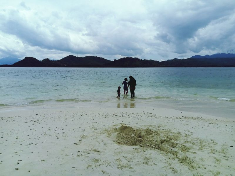 Togetherness Beach Bonding Full Length Two People Walking Sand People Pets Sea Nature Mountain Enjoyment Friendship Beauty In Nature Tranquility Leisure Activity Scenics INDONESIA Lampung