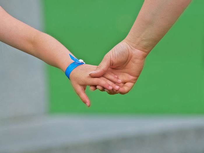 Togetherness Bonding Childhood Close-up Day Green Backgound Grey Background Human Body Part Human Hand Love Outdoors Real People Togetherness Two People