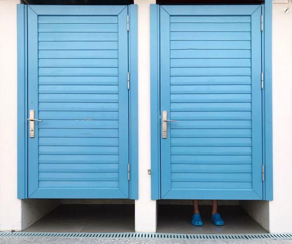 Closed blue doors of building