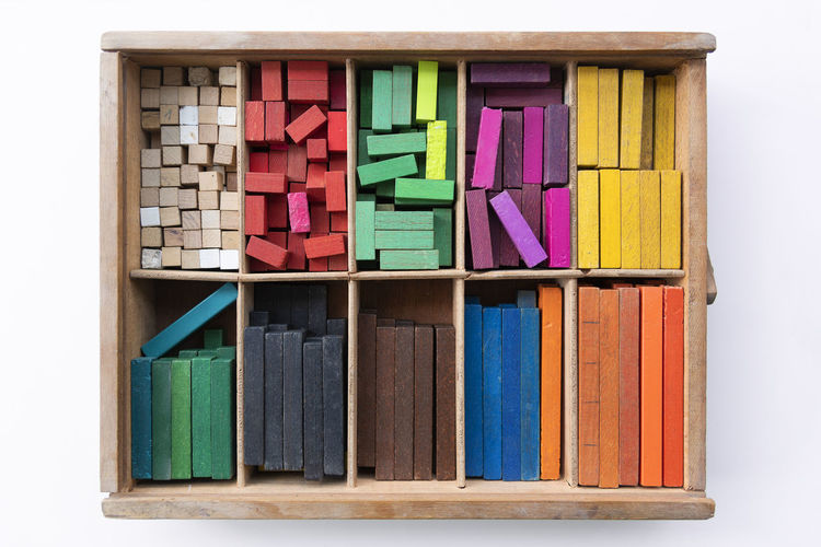 Colorful cuisenaire rods. Mathematics learning aids for students. Mathematical concepts. Box Square Box Choice Colorful Concept Container Cubes Design Education Equipment In A Row Indoors  Large Group Of Objects Learn Mathematics Multi Colored No People Object Order Sticks Still Life Variation Wood - Material Wooden