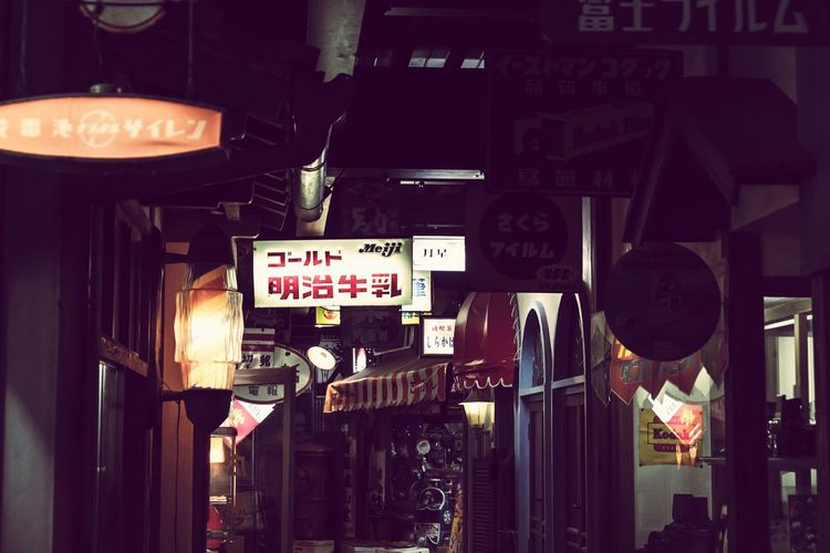 Text Western Script Communication Building Exterior Architecture Information Built Structure Road Sign Guidance Outdoors Store No People Night Illuminated City Neon Nostalgia Japan Japan Photography