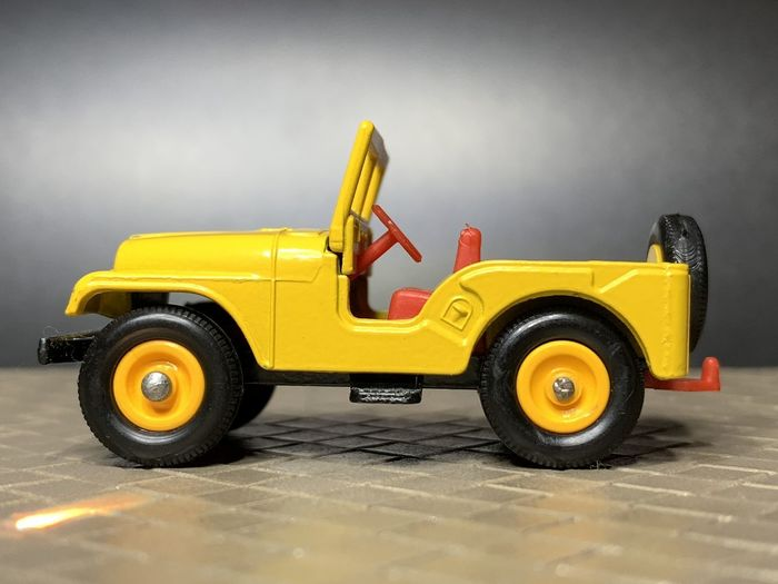 Close-up of yellow toy car on table