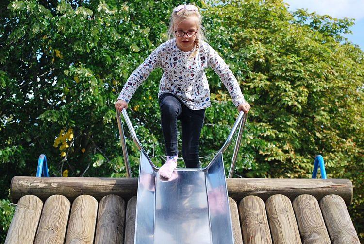 Girl Against Tree On Slide