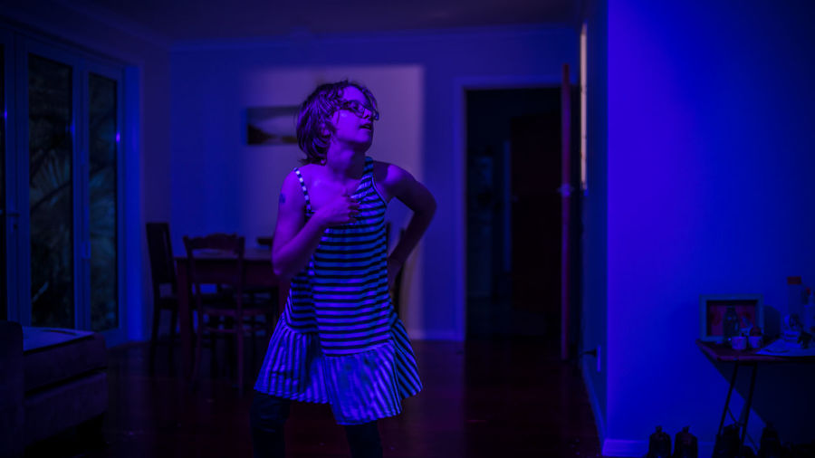 Dancing Glasses Blue Casual Clothing Domestic Room Front View Hairstyle Houseparty Illuminated Incidental People Indoors  Lifestyles Music Night Nightlife One Person Three Quarter Length Young Adult