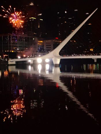 Puente De La Mujer Bridge Large Group Of People Fireworks New Year's Eve Fireworks New Year Celebration Reflection Night City Illuminated No People Transportation Water Outdoors Building Exterior Waterfront Architecture Sky