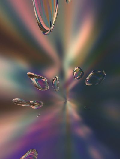 Close-up of bubbles against colored background
