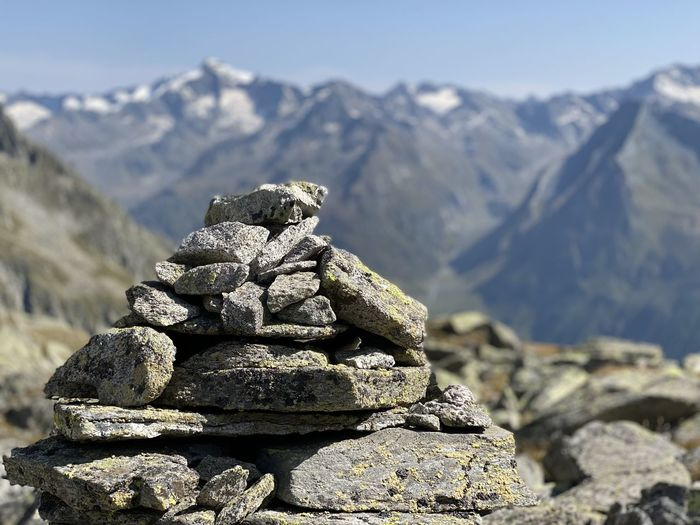 Stack of rocks against mountain