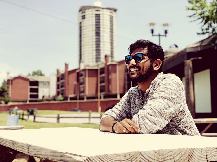 Smiling man sitting at outdoors cafe