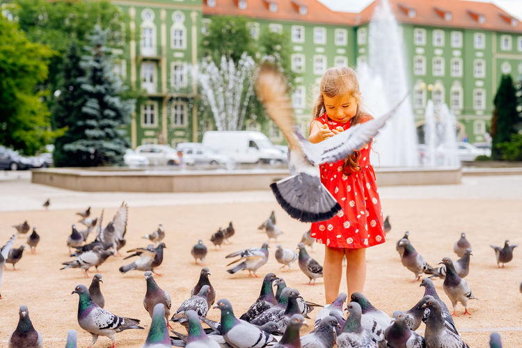 Woman with birds in background