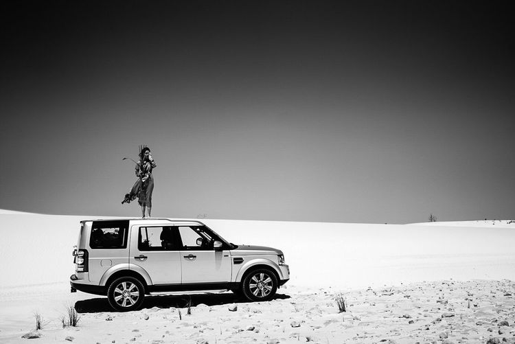 TwoWorlds Sand Desert Car Beach Arid Climate 4x4 Land Vehicle Clear Sky Hasselblad Photography Off-road Vehicle Outdoors Day Nature Vacations Sky Sea Real People Sand Dune One Person People Black And White Friday Be. Ready. The Traveler - 2018 EyeEm Awards