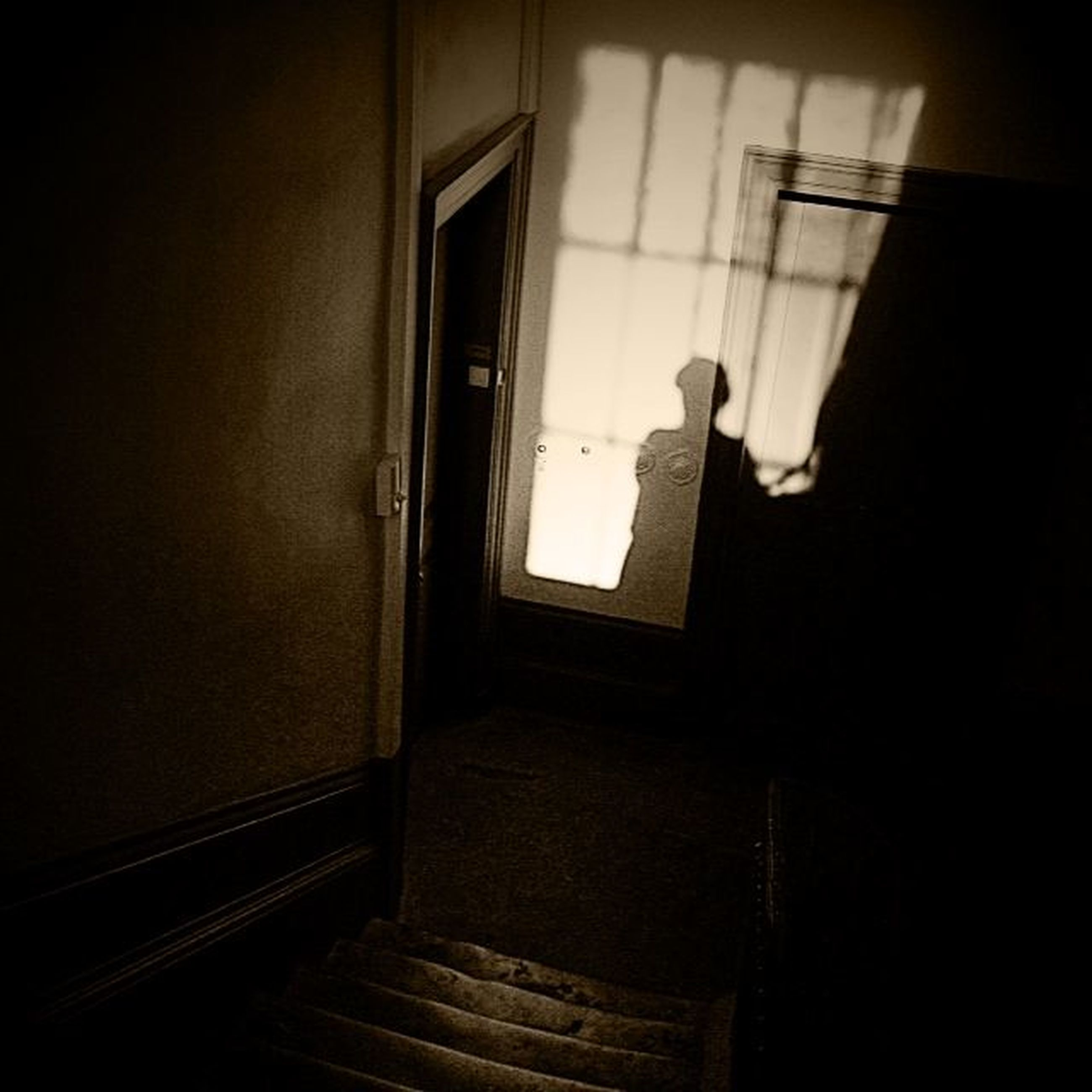 indoors, door, architecture, window, built structure, house, wall - building feature, home interior, one person, wall, doorway, open, dark, entrance, shadow, domestic room, sunlight, absence, day