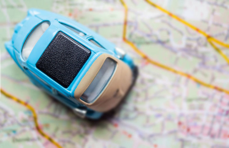 City Map Map Toy Car Travel Close-up Connection Direction Eyewear Focus On Foreground Guidance High Angle View Indoors  Leather Map Navigation No People Selective Focus Single Object Still Life Travel Destinations
