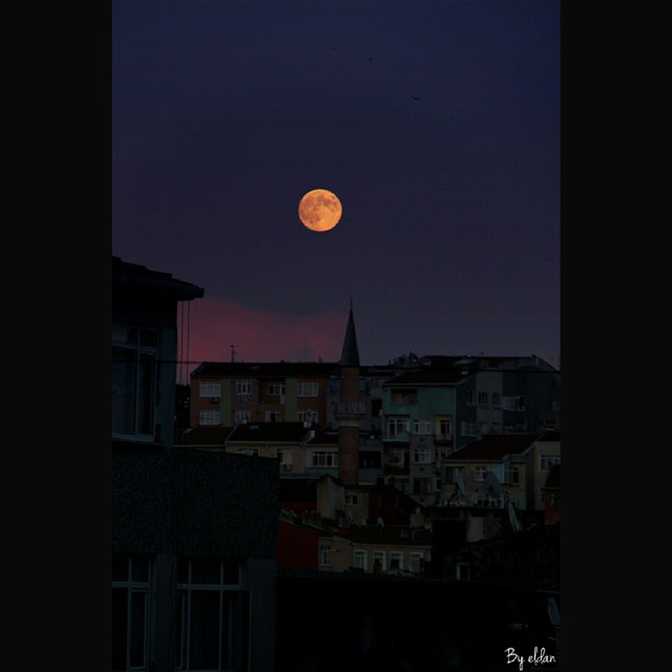architecture, building exterior, built structure, moon, night, sky, copy space, illuminated, residential structure, city, residential building, low angle view, building, dark, clear sky, house, dusk, outdoors, no people, window