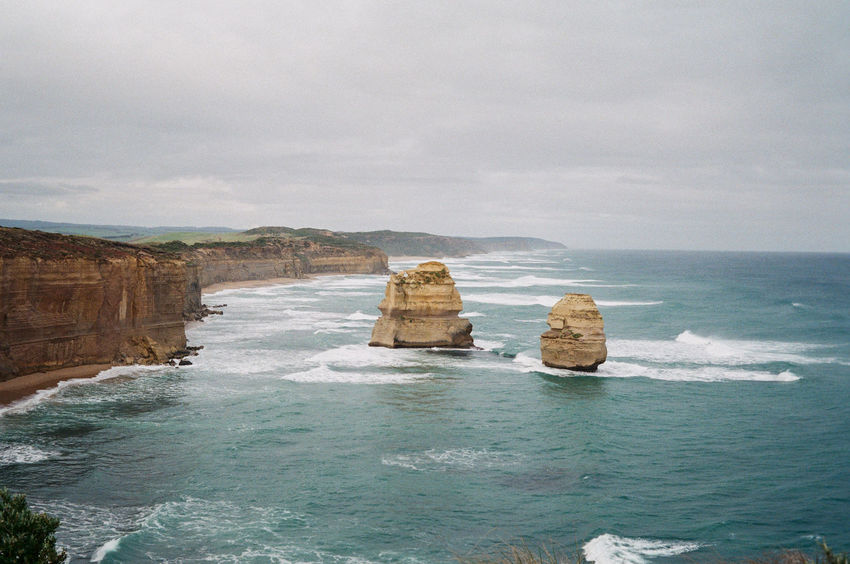 """Take """"Great Ocean Road Road Trip"""" in July 2018. Winter time in Australia is beautiful. Camera: Leica Minilux Film: Fuji Japan 100 Great Ocean Road Great Ocean Road Trip Road Trip Melbourne Leica Minilux Staybrokeshootfilm Ishootfilm Fuji Japan 100 Landscape Australian Landscape Nature Outdoors Beauty In Nature Ocean Australia Australia Road Trip Twelve Apostles Limestone Stacks Limestone Water Rock Rock Formation Stack Rock Port Campbell National Park"""