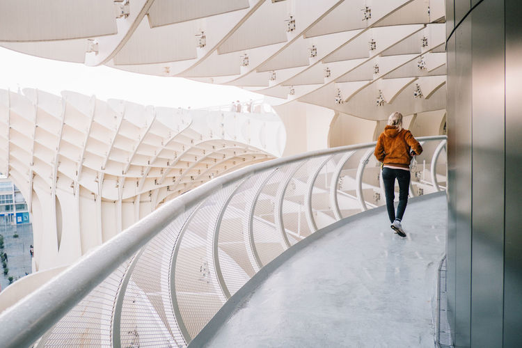 Sevilla / Spain EyeEmNewHere Metropol Parasol SPAIN Sevilla The Graphic City Architecture Built Structure Casual Clothing Day Full Length Indoors  Leisure Activity Lifestyles One Person Plaza De España Real People Rear View Standing Walking Women Young Adult Young Women