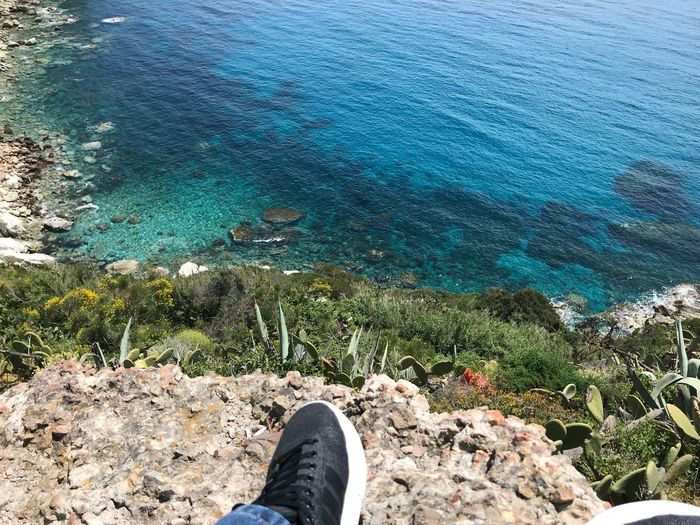 On the rocks for see transparent water Water Human Leg Low Section Real People Human Body Part Personal Perspective Body Part One Person Nature Sea High Angle View Day Lifestyles Leisure Activity Shoe Land Human Foot Blue Beauty In Nature Outdoors