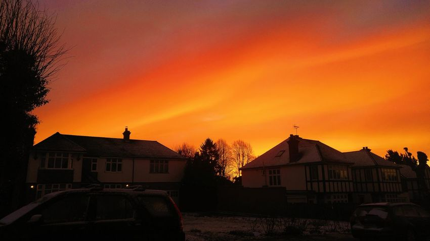 Winter orange sunset contrasting to the snow on the houses and ground Sunset Sky Day Morning Light Morning Sky Sunny Orange Red Snow Winter Contrast Early Morning Morning