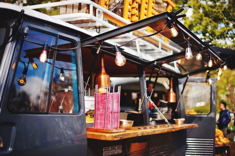 van with products and fast food Lighting Equipment Hanging Architecture Illuminated Business Built Structure Restaurant No People Lantern Outdoors Table Light Bulb Decoration Nature Retail  Street Building Day Building Exterior Store The Street Photographer - 2018 EyeEm Awards