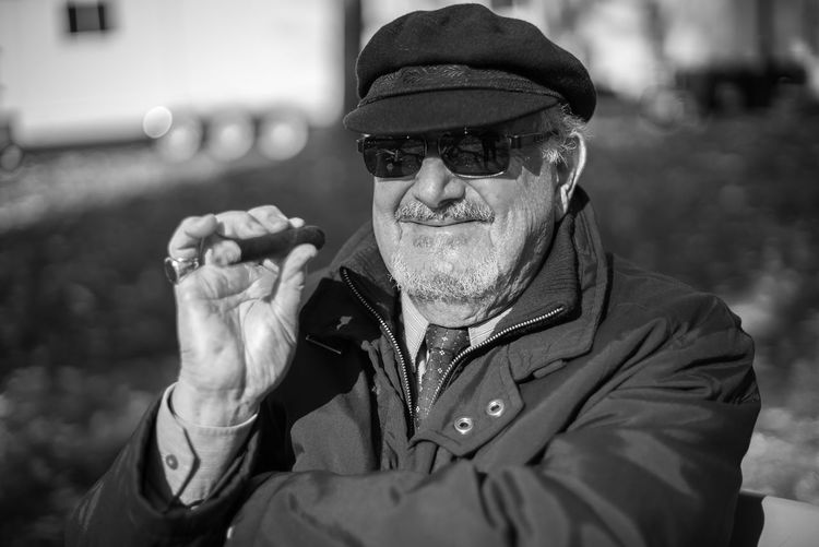 Bnw_collection Smoking Bad Habit Beard Black And White Cap Cigar Close-up Day Documentary Eyeglasses  Focus On Foreground Front View Leisure Activity Lifestyles Mature Men One Person Outdoors Park Portrait Real People Senior Adult Senior Man Streetphotography Sunglasses Fashion Stories The Art Of Street Photography