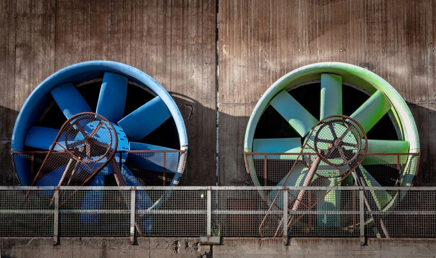 Large wheels against built structure