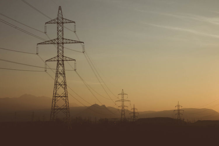 EyeEmNewHere Cable Clear Sky Connection Day Electricity  Electricity Pylon Electricity Tower Fuel And Power Generation Landscape Low Angle View Nature No People Outdoors Power Line  Power Supply Silhouette Sky Sunset Technology